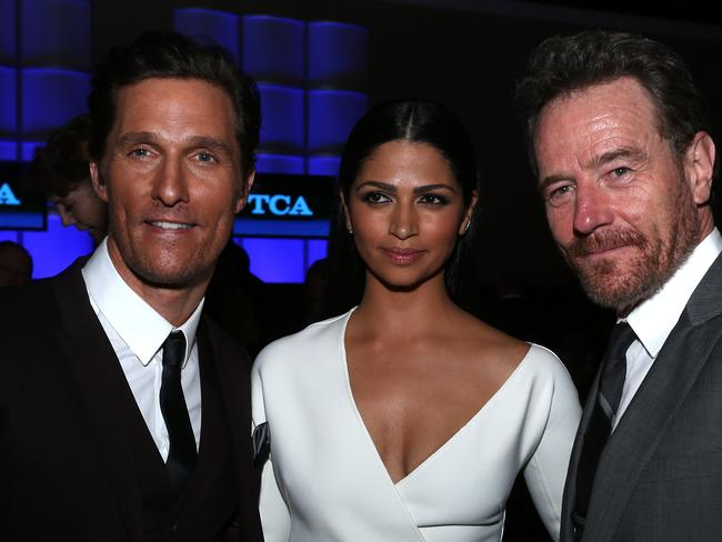 Wave of success ... Matthew McConaughey, model Camila Alves and actor Bryan Cranston at the Annual Television Critics Association Awards. Picture: Frederick M Brown
