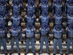 New Washington State Patrol troopers bow their heads during a prayer at the Patrol's graduation ceremonies in the Capitol rotunda, Wednesday, April 26, 2017, in Olympia, Wash. The 49 graduates of the 107th Trooper Basic Training Class went through nearly six months of field and academy training, and were given the oath of office by Washington State Supreme Court Justice Mary Fairhurst. (AP Photo/Elaine Thompson)