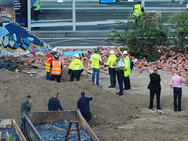 Building inspectors and police examine the site after the collapse. Picture: Alex Coppel