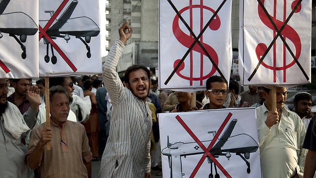 Supporters of Pakistan's Islamist party Pasba, rally against US drone strikes on hideouts of militants in the country's tribal areas, in Karachi, Pakistan.