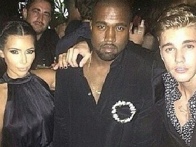 Here's trouble ... Kim Kardashian, Kanye West and Justin Bieber party together.