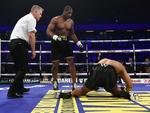 Daniel Dubois knocks down AJ Carter during the vacant BBBofC Southern Area Heavyweight Title fight at Copper Box Arena on September 16, 2017 in London, England. Picture: Leigh Dawney/Getty Images