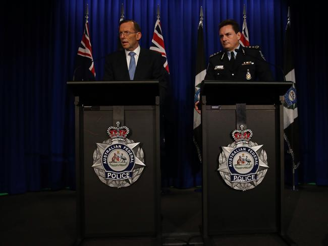 The Prime Minister Tony Abbott with AFP Commissioner Tony Negus. A hundred more AFP officers are flying to Europe to assist with securing the MH17 site.