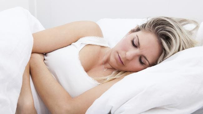 Unwell ... a woman suffering with PMS during her period. Picture: Thinkstock