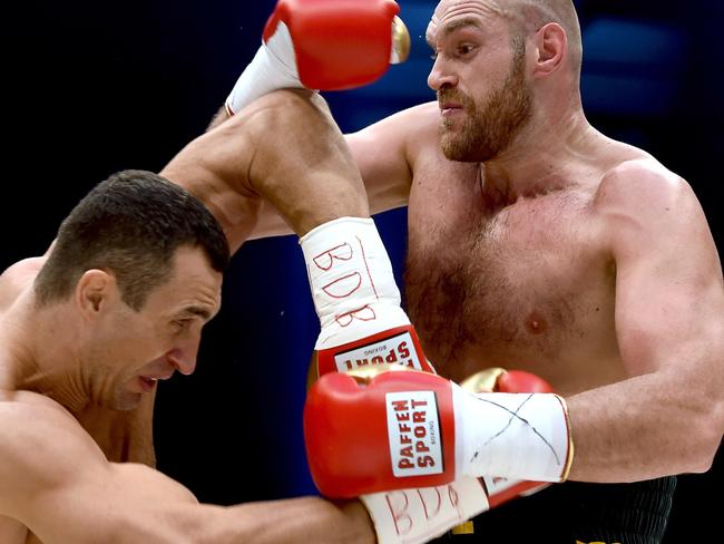 Fury conquers Klitschko for heavyweight crown
