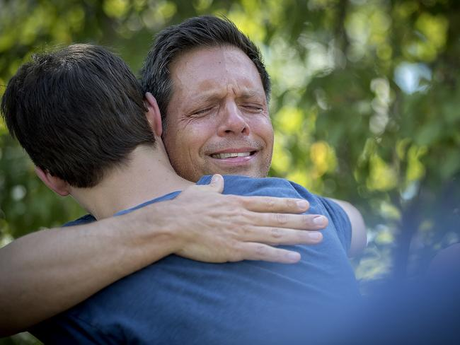 Devastated... Don Damond is comforted by friends and family. Picture: Elizabeth Flores/Star Tribune