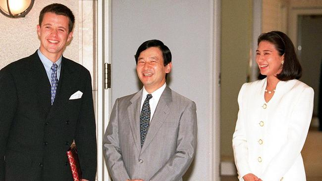 Visiting Danish Crown Prince Frederik, left, shares a laugh with Japanese Crown Prince Naruhito and Crown Princess Masako, upon his arrival at the official residence of the Japanese royal couple in Tokyo in 1997. Picture: AP / Toru Yamanaka.