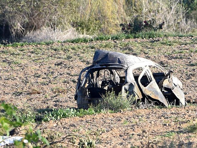 The wreckage of the car of investigative journalist Daphne Caruana Galizia lies next to a road in the town of Mosta, Malta. Picture: AP