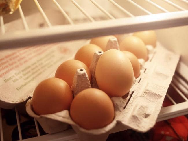 You are better off storing the eggs further back in the fridge,