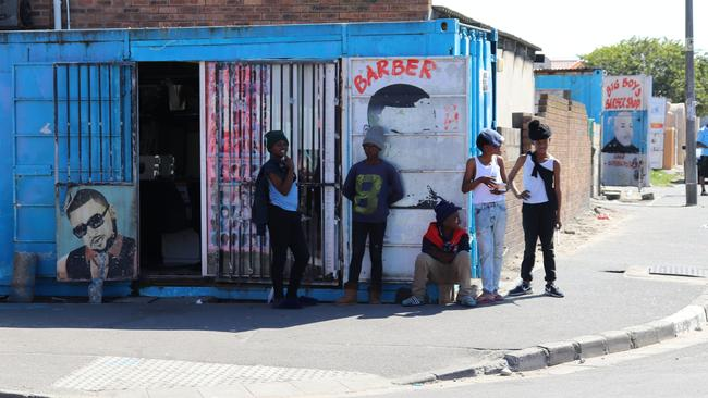 Youths hang out on a street corner in the South African township of Langa. Picture: Megan Palin.