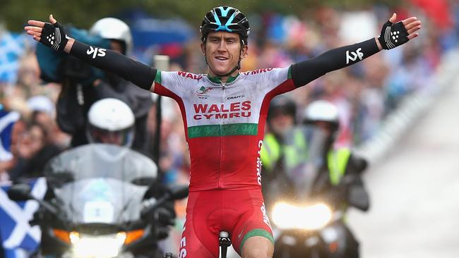 Geraint Thomas of Wales celebrates as he crosses the finish line.