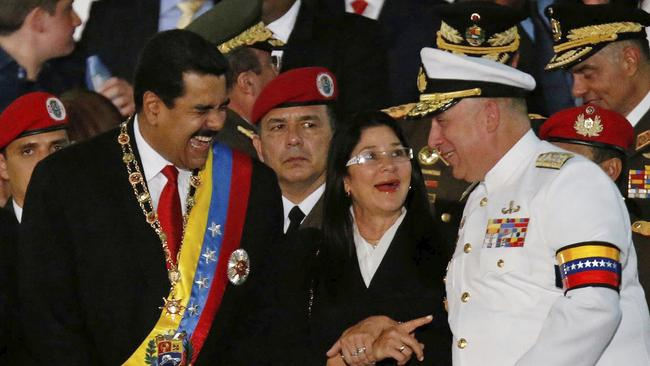 Venezuela's President Nicolas Maduro, left, speaks with Defense Minister Admiral Diego Molero (AP Photo/Fernando Llano, File)