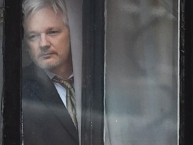 This file photo taken on February 05, 2016 shows WikiLeaks founder Julian Assange coming out on the balcony of the Ecuadorean embassy to address the media in central London. Picture: AFP.