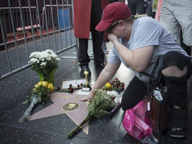 Much loved ... a woman expresses grief besides Robin Williams' star on the Hollywood Walk of Fame on August 11, 2014. Picture: Robyn Beck