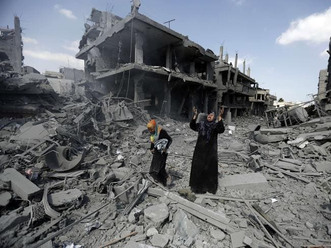 Ceasefire ... a Palestinian woman cries amid destroyed buildings in the northern district of Beit Hanun in the Gaza strip during an humanitarian truce.