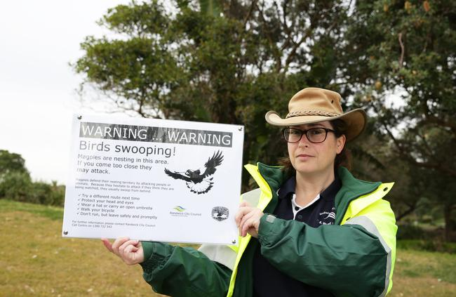 Randwick Council ranger Leanne Bunn with a sign warning about swooping magpies at Arthur Byrne Reserve, Maroubra. Picture: Craig Wilson