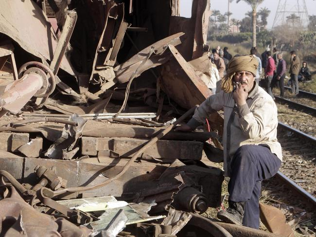 An Egyptian railway worker surveys the wreckage from the site of a train accident in 2013 in Badrasheen, 40km south of Cairo. Picture: Amr Nabil/AP