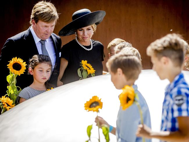 Dutch King Willem-Alexander (left) and Queen Maxima (centre) attend the unveiling of the national monument for the MH17 victims in Vijfhuizen. Picture: AFP/ANP/Remko de Waal