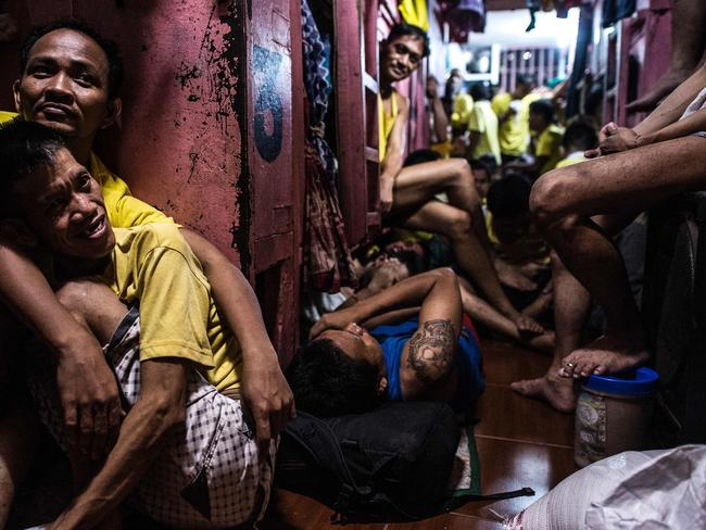 Inmates rest in their sleeping quarters inside the Quezon City jail at night. Picture: Ayee Macaraig