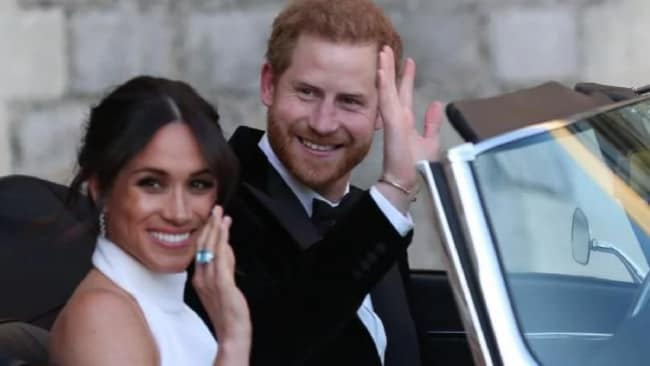 Meghan & Harry leaving their reception, with Meghan wearing Harry's gift to her: a ring that previously belonged to Diana. Photo: Mega