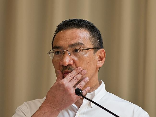 Under pressure ... Malaysian Minister of Defence and Acting Transport Minister Hishammuddin Hussein gestures as he listens to questions.