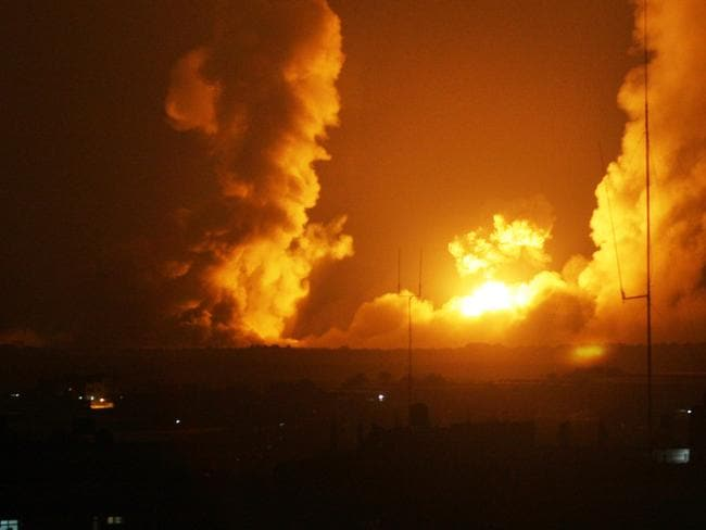 Striking back ... A ball of fire is seen following an Israel air strike in Rafah, southern Gaza.