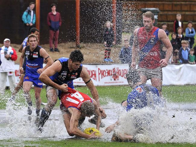 Medibank Stadium was a virtual swimming pool for the WAFL game between East and West Perth. Picture: Theo Fakos