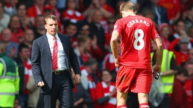 Manager Brendan Rodgers of Liverpool looks to dejected skipper Steven Gerrard.