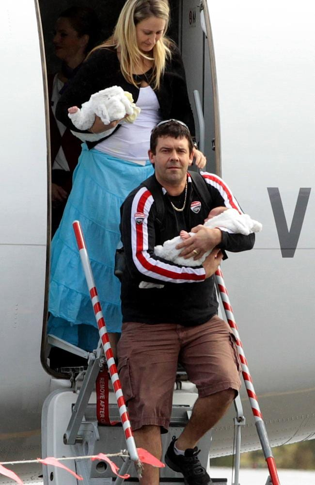 Kempsey couple Adam and Kate Osborne arrive at Port Macquarie Airport from Bangkok with their Thai surrogate twin babies Mali and Sierra-Leone / Picture: Nathan Edwards