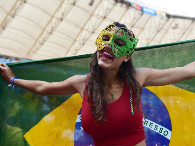 A fan cheers prior to the Group G football match between Portugal and Ghana at the Mane Garrincha National Stadium in Brasilia.