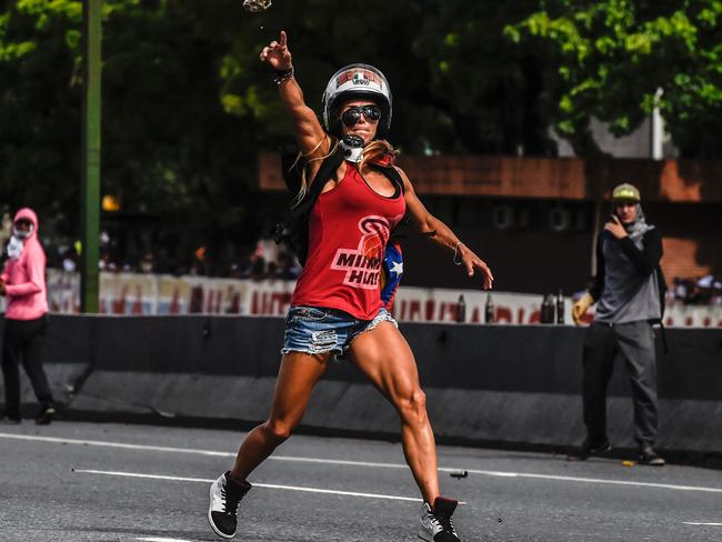 Opposition activist Caterina Ciarcelluti clashes with the police during a march against the Venezuelan President last month. Picture: Juan Barreto/AFP