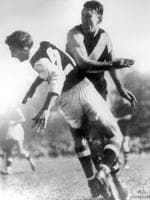 Jack Dyer collides with St Kilda's Tom Meehan in 1949 at Punt Rd.