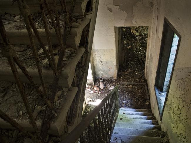 Inside the station ... stairs in the kitchen area on Poveglia Island. Picture: Ella Pellegrini