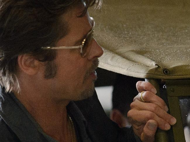 "US actor Brad Pitt wearing his wedding ring arrives for a photocall to promote his latest film ""Fury"" at Bovington tank museum in Dorset, southern England. Picture: Leon Neal"