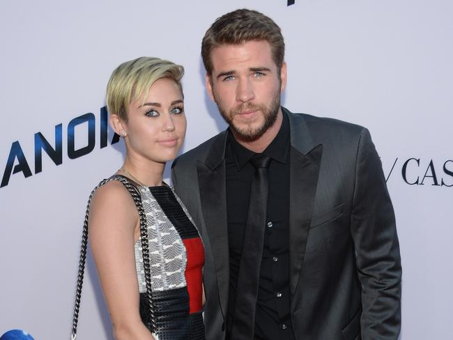 Final days ... Cyrus and Hemsworth's last public outing as a couple, at the premiere of his thriller Paranoia in LA last August. Picture: Getty