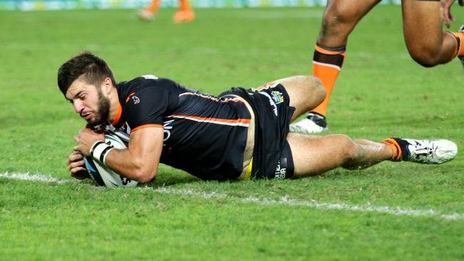 Tiger's fullback James Tedesco scores a try.