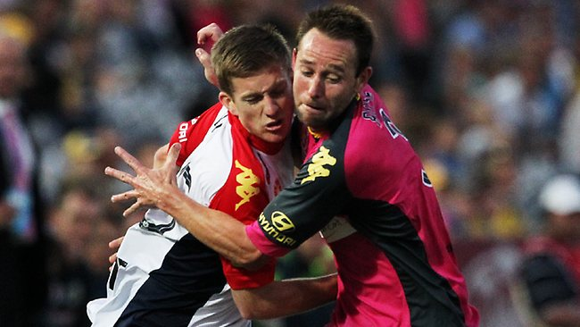 Ryan Kitto tangles with Mariners defender Joshua Rose.