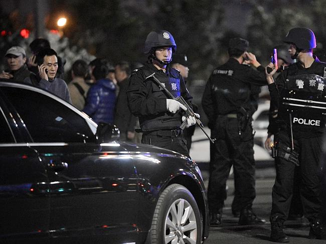 Police officers ... investigate and protect the crime scene outside a railway station in Kunming, in southwestern China's Yunnan province. Picture: AP