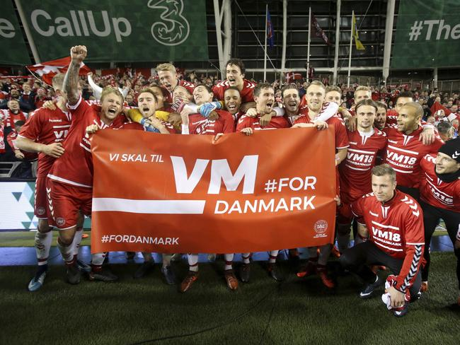 Denmark celebrates its win against Ireland. (AP Photo/Brian Lawless, PA via AP)