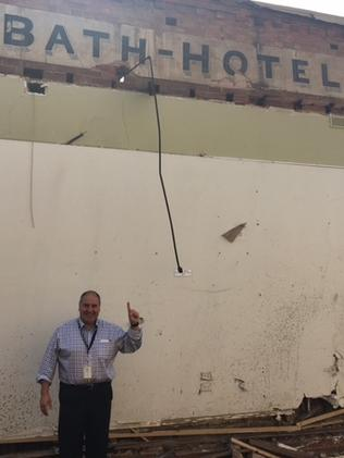 Bath Hotel owner Tony Franzon with the original Bath Hotel sign, uncovered during demolition to make way for the new apartments.