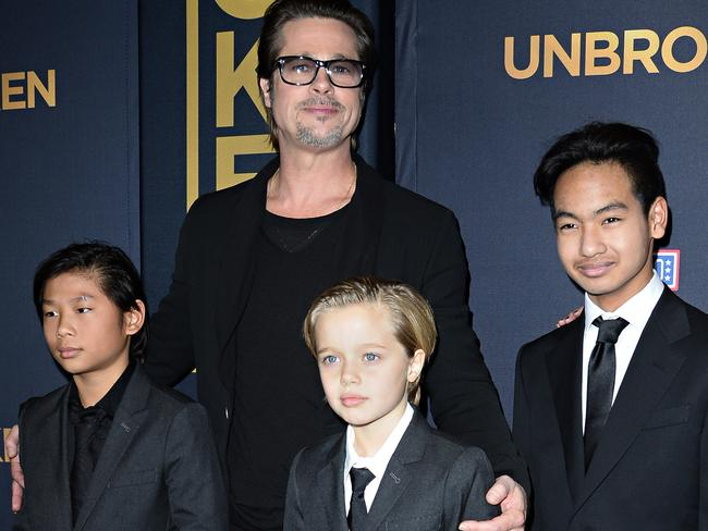 Brad Pitt with his children Pax, Shiloh and Maddox at the Unbroken premiere in California in 2014. Picture: Robyn Beck.
