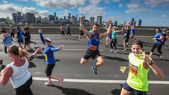 Happy runners cross the Bolte Bridge. Picture: Mark Dadswell