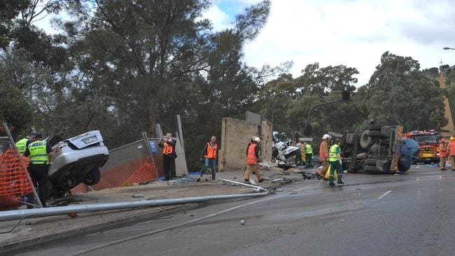 Emergency service workers at the crash scene. Picture: Roger Wyman