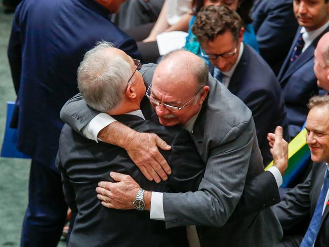 Warren Entsch hugs Malcolm Turnbull after the Parliament passed the same-sex marriage bill.
