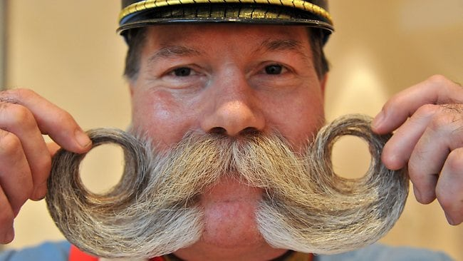Franz Schani Mitterhauser shows his beard with which he competes in the Whiskers Freestyle category. Pictures: AAP