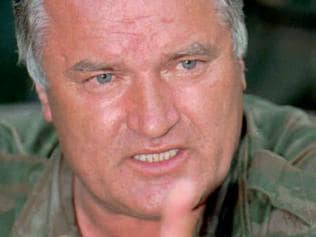(FILES) This file photo taken late on July 26, 1995 shows Bosnian Serb Army commander General Ratko Mladic, who was indicted 25 July by the International War Crimes Tribunal in The Hague, speaking to reporters in the eastern Bosnian enclave of Zepa. UN war crimes judges will on November 22, 2017 hand down a historic verdict against former Bosnian Serb army commander Ratko Mladic, blamed for steering Europe's worst atrocities since World War II. / AFP PHOTO / POOL / Sava RADOVANOVIC