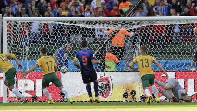 Australia's Mile Jedinak slots home a penalty.