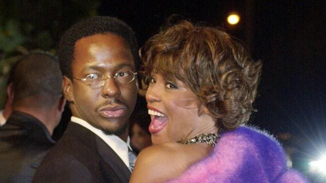Bobby Brown and his then wife Whitney Houston arrive at Vanity Fair's Oscar party in 2001.