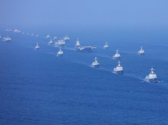 A formation of Chinese warships parade for President-for-life Xi Jinping earlier this month. Picture: Xinhua