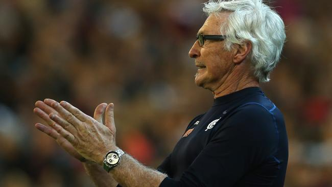 Mick Malthouse coaches from the boundary line against Essendon.